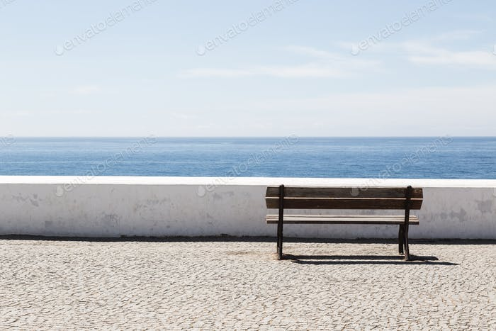 Empty bench in front of the Atlantic Ocean