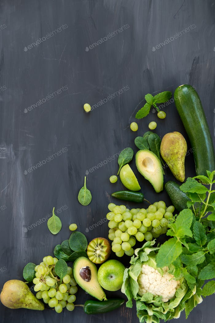 All green Vegetables and Fruits on Dark Background