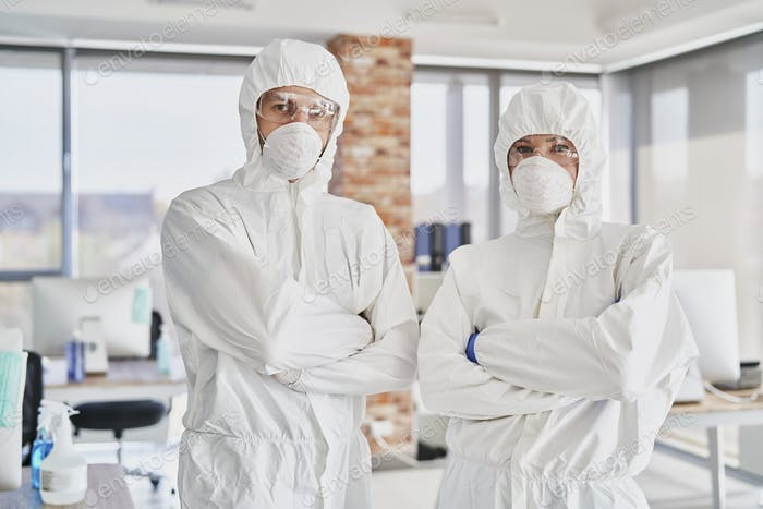 Portrait of two technicians in protective workwear in the office
