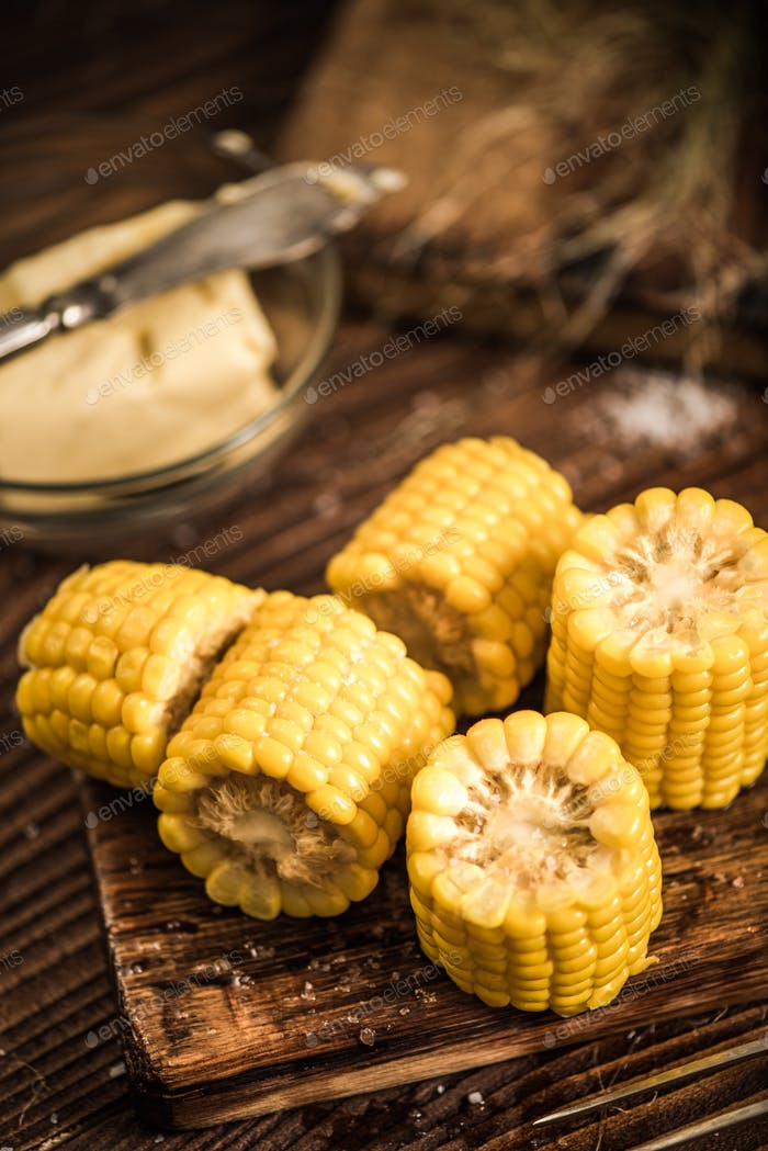 Cooked and salted corn on cob with butter