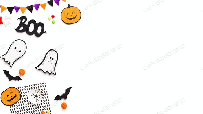 Halloween party and holiday background with paper ghosts
