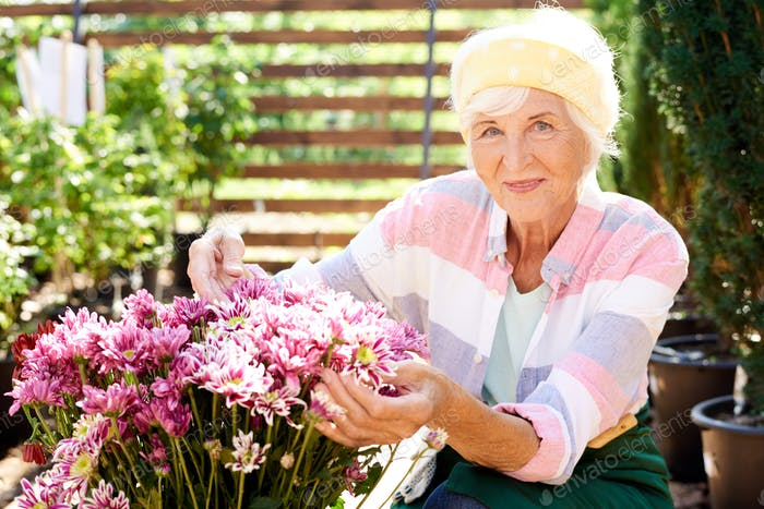 Senior Woman Posing with Bouquet