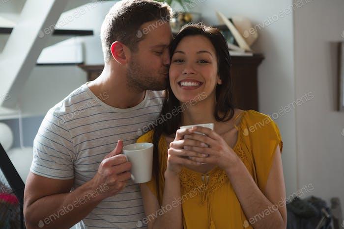 Romantic couple having coffee at home