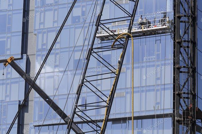 Highrise window washers on scaffolding