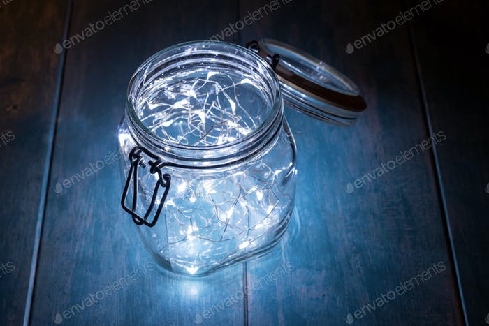 Glass jar filled with decorative lights