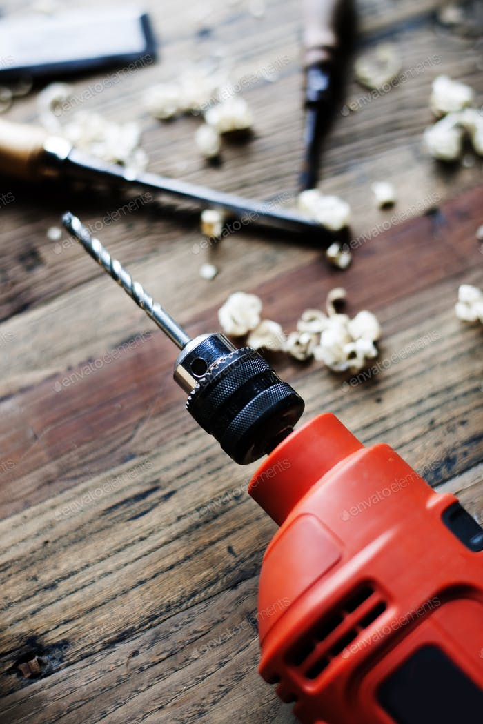 Closeup of drill on wooden table