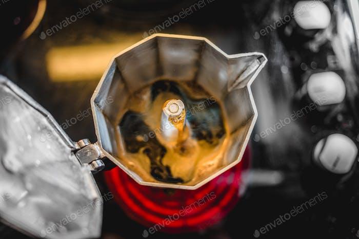 Italian Aluminum Coffee Maker Brewing a Fresh Dark Coffee on the