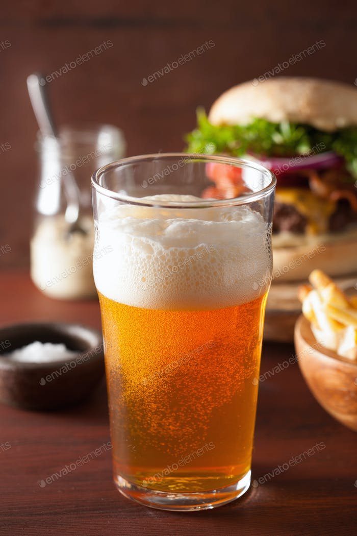 pint glass of india pale ale beer and fastfood