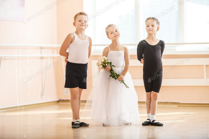 Young boys and a girl with flowers posing gracefully