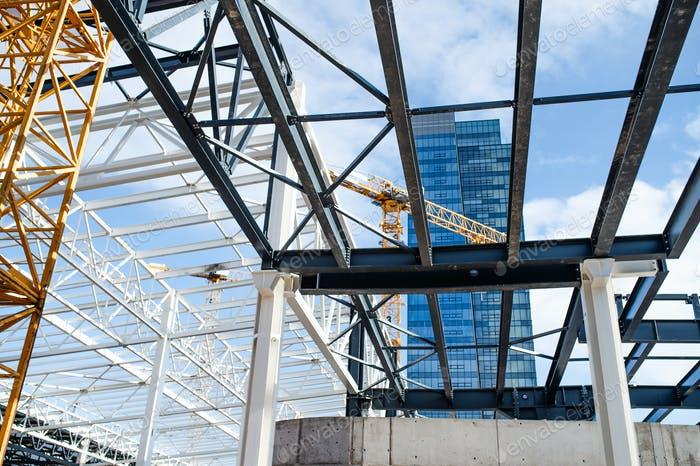 Construction site with steel frame structure and crane
