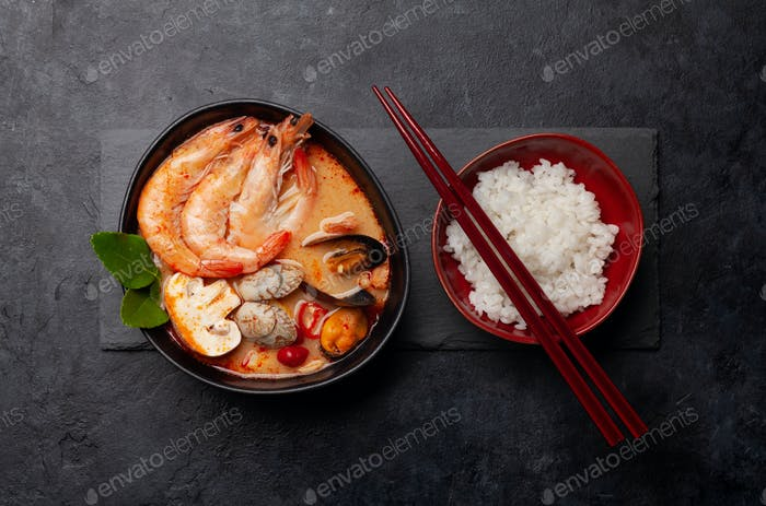Traditional Thai soup Tom Yum and rice bowl