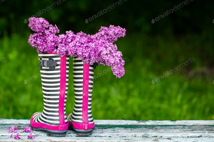 Rubber boots with a bouquet of flowers. creative.