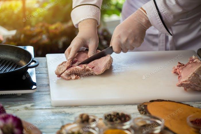 Knife cuts raw meat