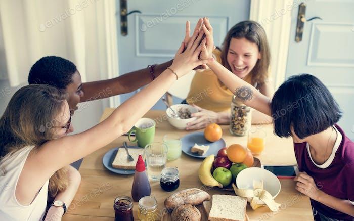 Diverse women hands together teamwork
