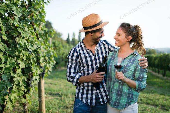 Happy couple in vineyard before harvesting
