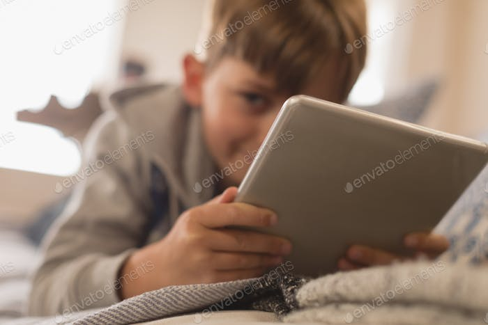 Thumbnail for Close up of young boy using digital tablet in living room at home