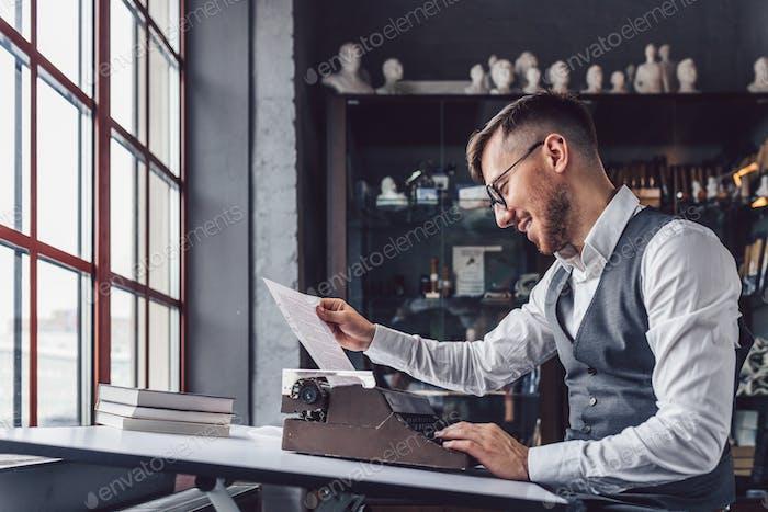 Smiling professional with retro typewriter