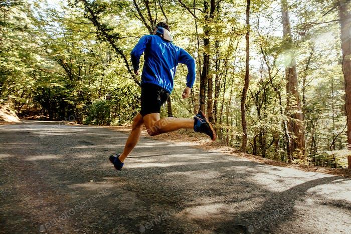 male runner running on forest