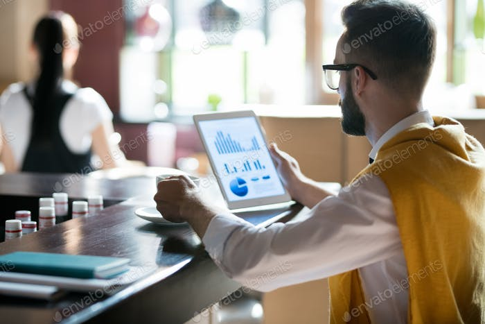 Businessman Working in Bar
