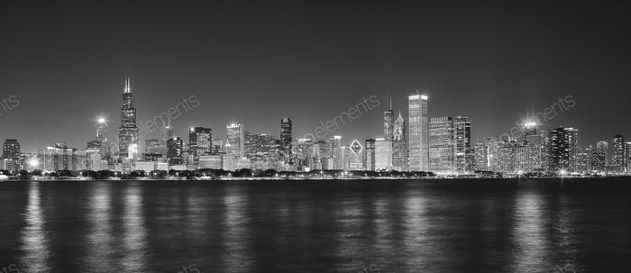 Black and white panoramic picture of Chicago city skyline at nig