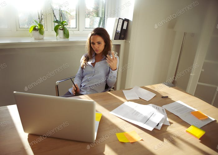 Young businesswoman working on new business plan