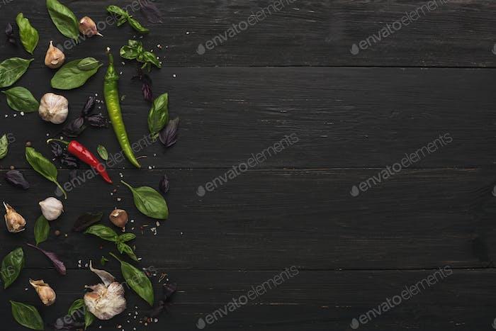 Border of fresh vegetables on wooden background