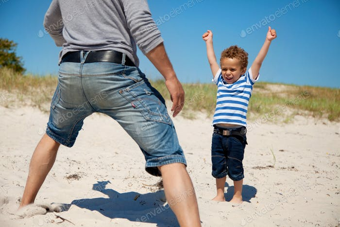 Energetic Kid Raises Arms