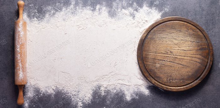 Flour food and pizza cutting board as bakery concept for homemade bread baking on table
