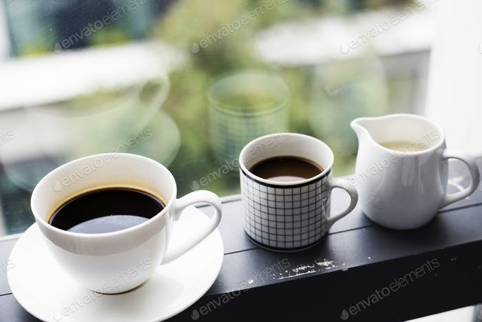 Closeup of coffee cups by the window