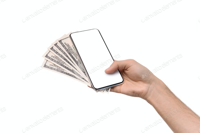 Male hand holding blank cellphone and bunch of dollar banknotes