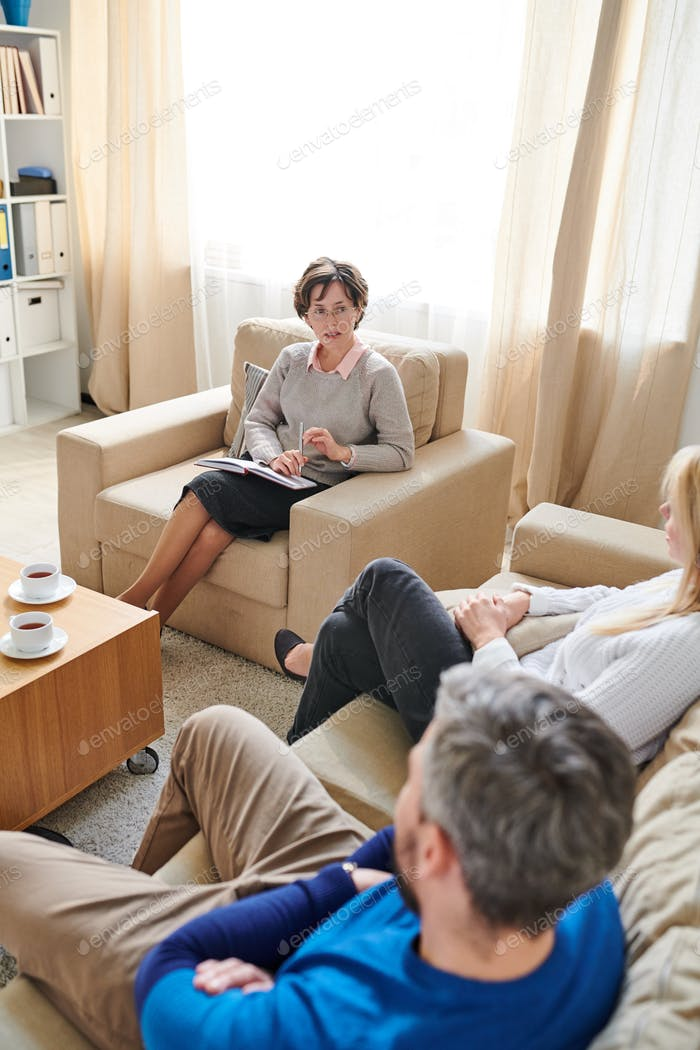 Qualified therapist talking to couple about their problems
