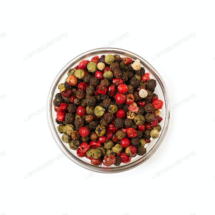 Mix of pepper in a bowl isolated on a white background