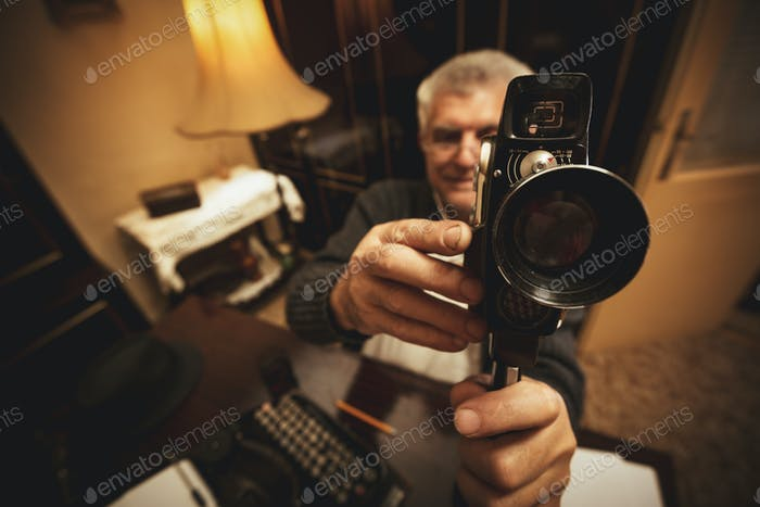 Senior Man Holding Video Camera