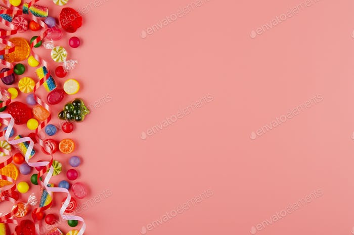 Flat lay view at sweet background of different type color and taste candies