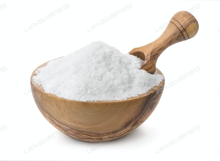 Wood bowl full of cooking salt with scoop