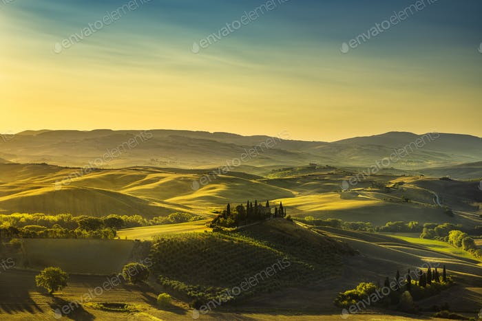 Tuscany countryside panorama, rolling hills and fields at sunris