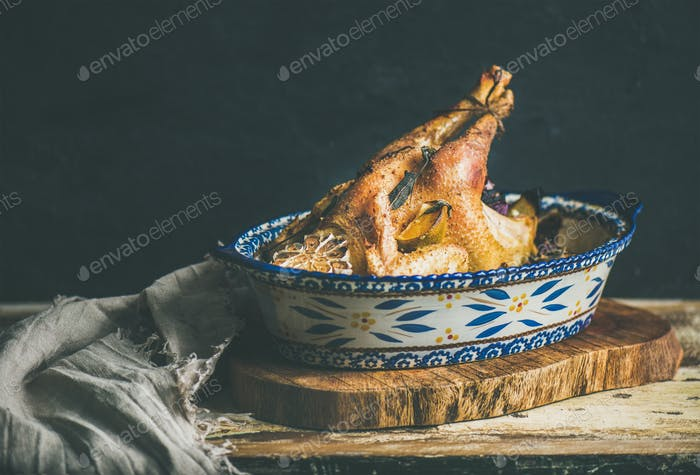 Roasted whole chicken for Christmas eve celebration table