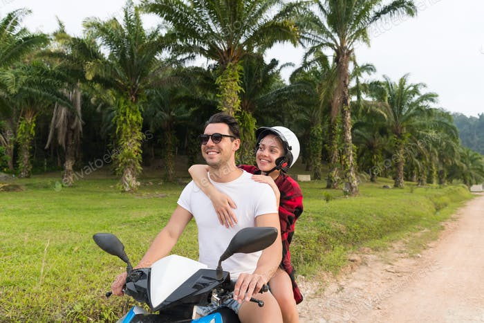 Couple Riding Motorbike, Young Man And Woman Travel On Bike On Tropical Forest Road