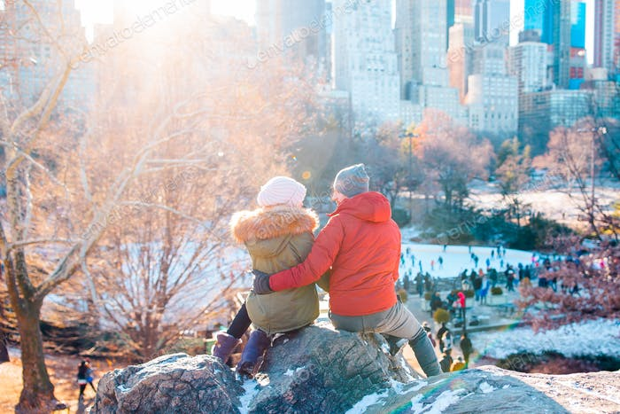 Happy couple enjoy the view of famous ice-rink in Central Park in New York