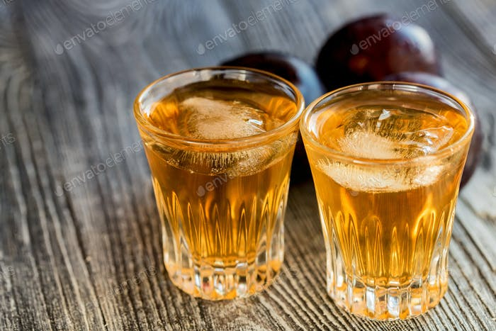 Plum brandy or slivovitz with fresh and tasty plum
