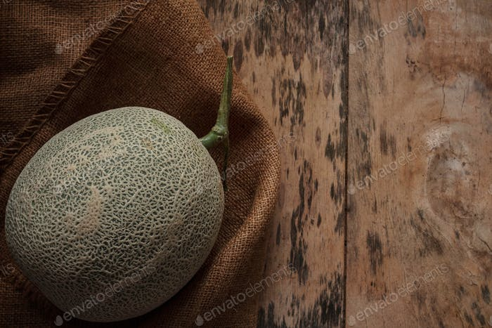 Melon on old sack
