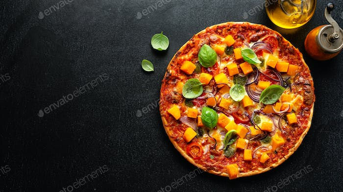 Pizza with pumpkin chunks with vegetables