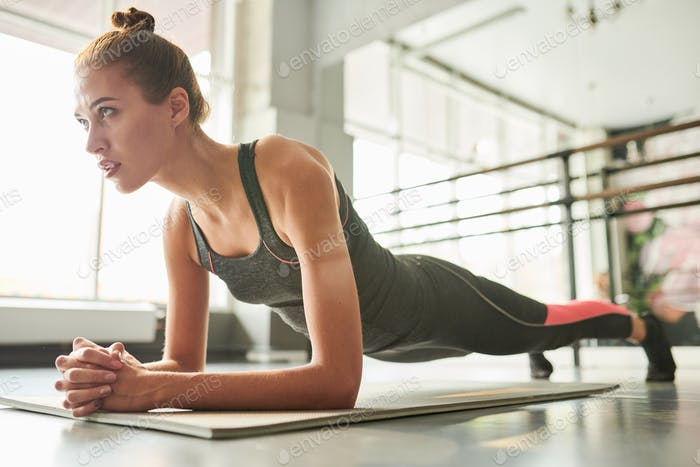 Contemporary Woman Doing Plank Exercise
