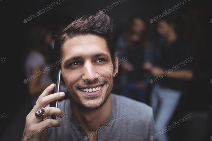 High angle view of young man talking on mobile phone