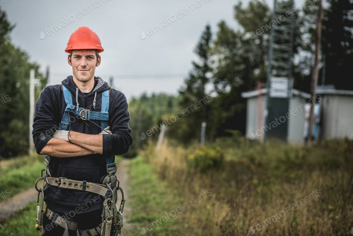 Cheerful technician at telecom�tower