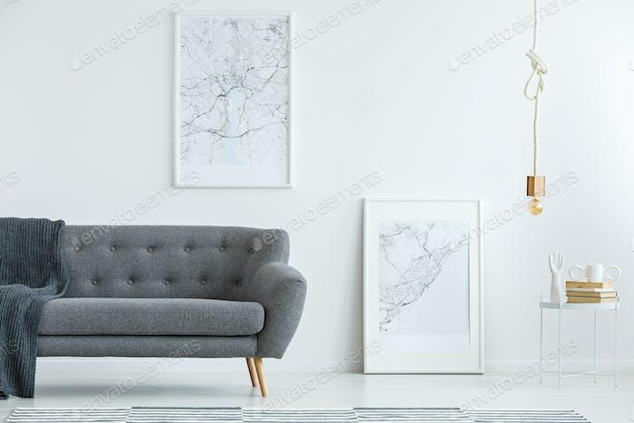 Elegant sofa and map posters