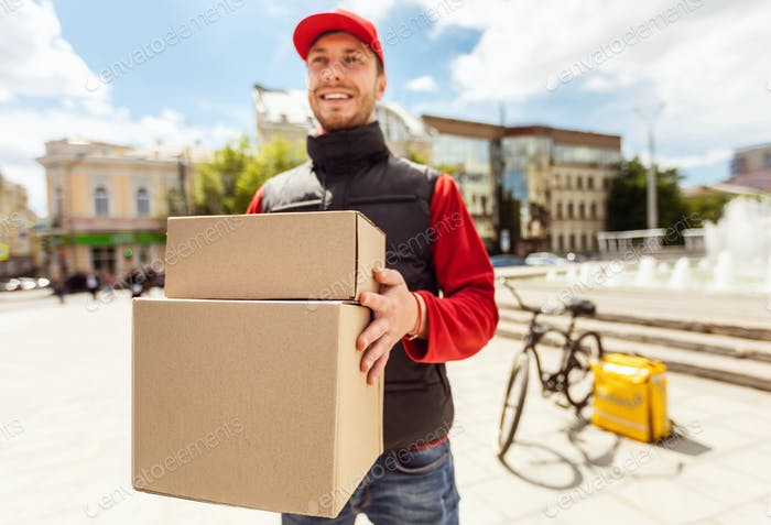Courier Man Delivering Boxes, Parcels And Food In City