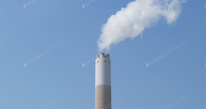 Smoke from factory over blue sky
