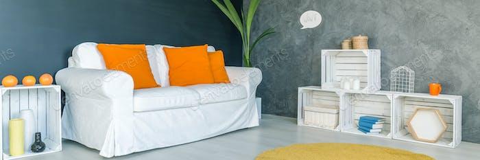 Sofa with orange cushions