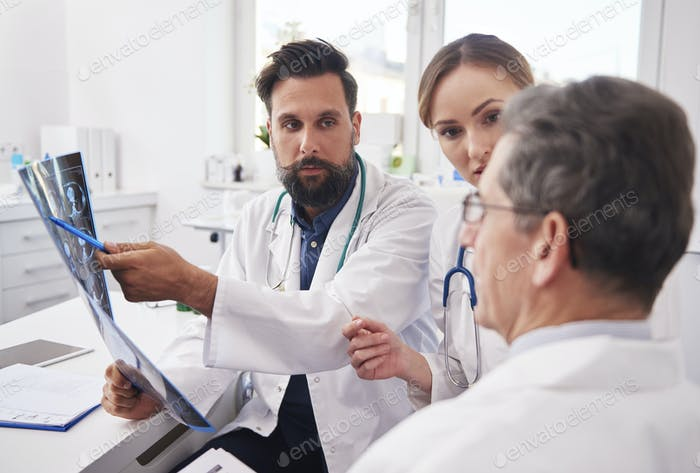 Group of doctors looking at the results of the radiology